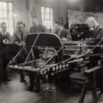 At workshop of Grandfather's contemporary, John Cobb (fourth from left) who was sadly killed whilst attempting a speed record